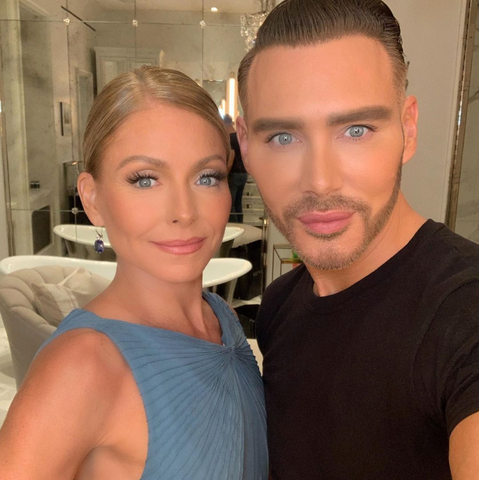 Kristofer Buckle takes a picture with Kelly Ripa