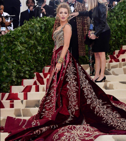 Blake Lively walks red-carpet at met gala in red and gold dress