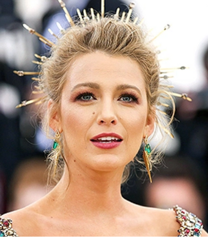 Blake Lively has glam makeup and gold crown at met gala red carpet