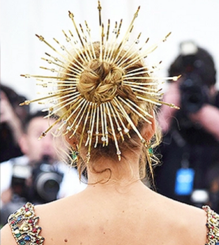 The back of blake lively's hair with a gold crown in it for the met gala