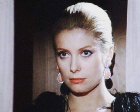 A picture of Catherine Deneuve taken in the 1960s on a movie set.
