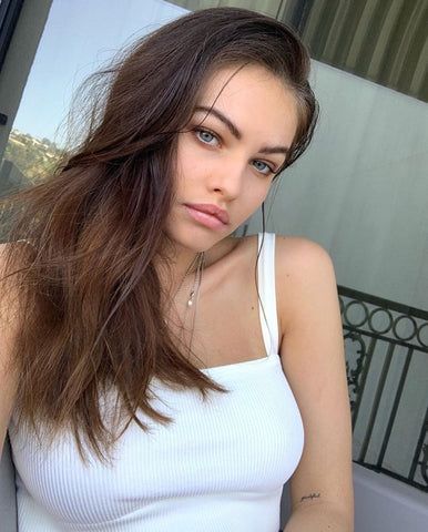 Model, Thylane Blondeau, takes a picture with minimal makeup and a white tank top on