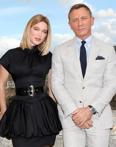 Daniel Craig takes a picture with his significant other at an Omega watch event