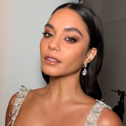 Vanessa Hudgens with slicked hair and flawless makeup