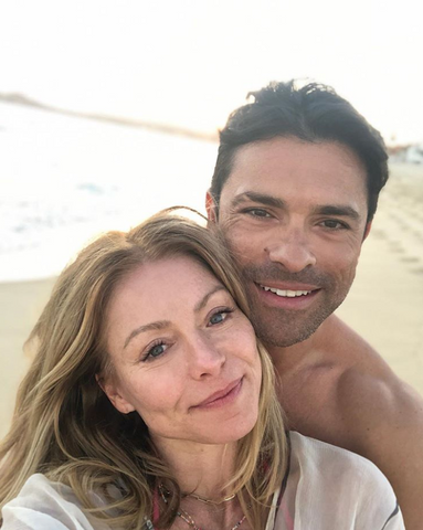 Kelly Ripa wears minimal makeup and takes a beach picture with her husband.