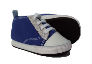 Baby shoes shown in the blue sneaker style. Right shoe is on it's side showing the chalkboard sole.