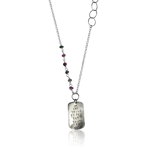 "Gogh Jewelry Design's grounding necklace etched with: ""DO ONE THING EVERY DAY THAT SCARES YOU"""