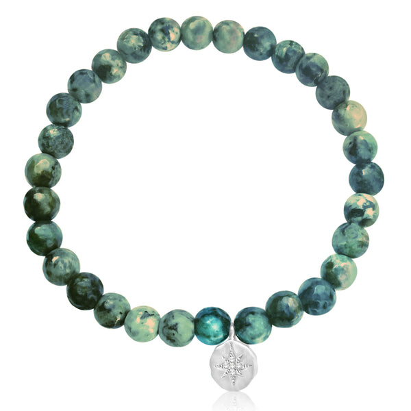 Enjoy the Journey African Turquoise Bracelet with Sterling Silver Compass Charm. Be present wherever you are in your life and in the world. Enjoy every moment of your journey! Turquoise is perhaps the oldest stone in man's history, the talisman of kings, shamans, and warriors.