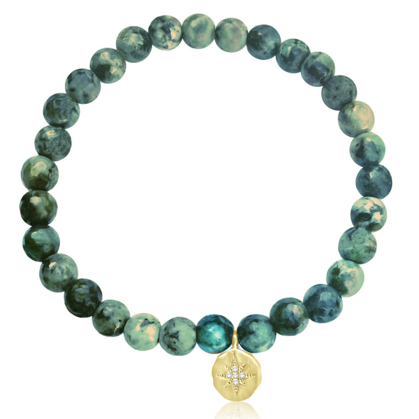 Enjoy the Journey African Turquoise Bracelet with Yellow Gold Compass Charm. Be present wherever you are in your life and in the world. Enjoy every moment of your journey! Turquoise is perhaps the oldest stone in man's history, the talisman of kings, shamans, and warriors.