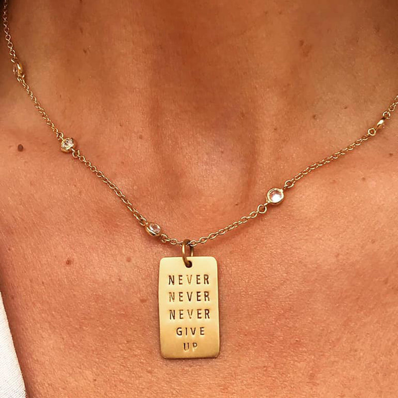 Lu Parker from KTLA wears Never Give Up Gold Filled Dog Tag Necklace w/ Rainbow Crystals