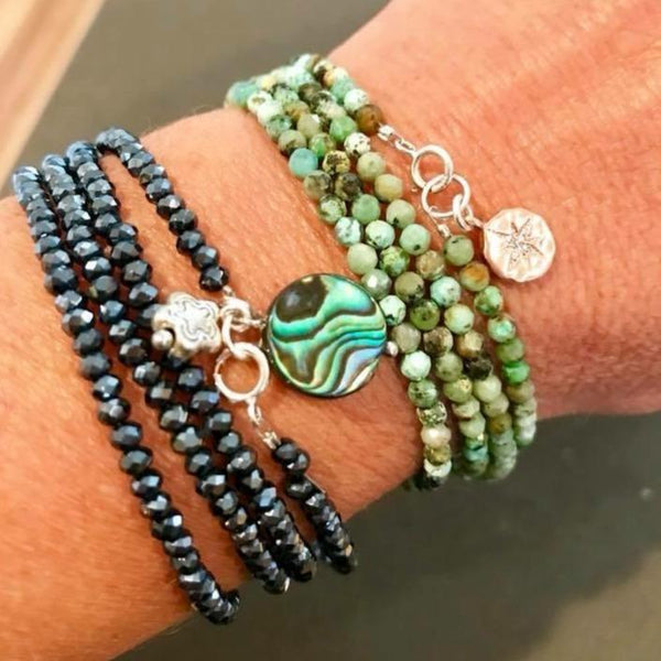 Enjoy the Journey African Turquoise with Rose Gold (gold filled) Compass Charm & Ocean Beauty Wrap Bracelet with Abalone and Beach Flower Charms embellished Midnight Dark Crystal. Inspirational Adventure Travel Jewelry.