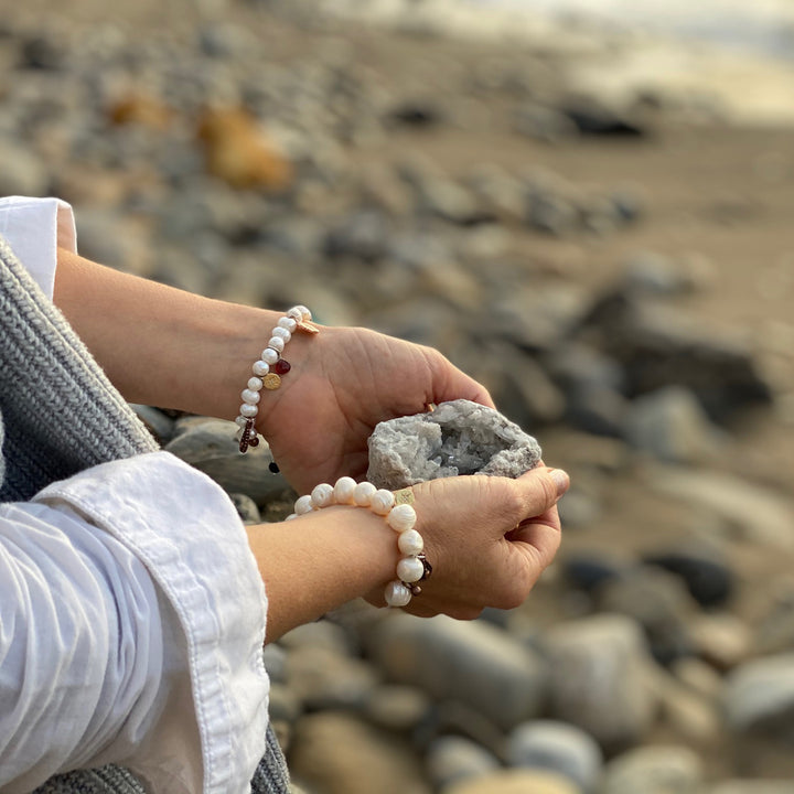 "Find Your True North Pearl Bracelet with Silver, Gold, Brass and Rose Gold Charms. Just as a compass points toward a magnetic field, your personal ""true north"" directs your path and pulls you forward. Pearl is the ""Stone of Truth, Faith and Love,"" enhances personal integrity and helps provide focus."