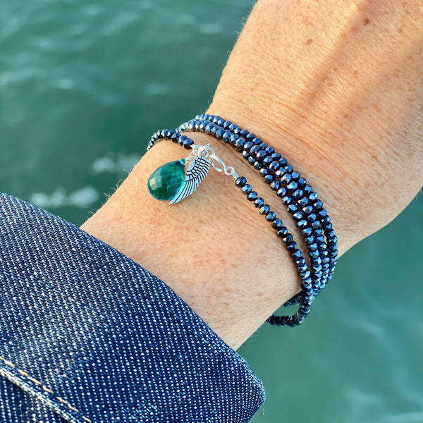 Protective Angel Wrap Bracelet with Aquamarine Quartz Charm on Midnight Dark Crystal