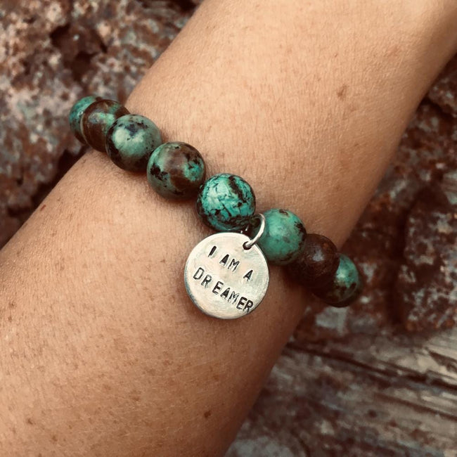 I am a Dreamer Affirmation Bracelet with African Turquoise. With a little imagination and a lot of drive, you have the power to contribute to the world, or even change it. So be a dreamer.
