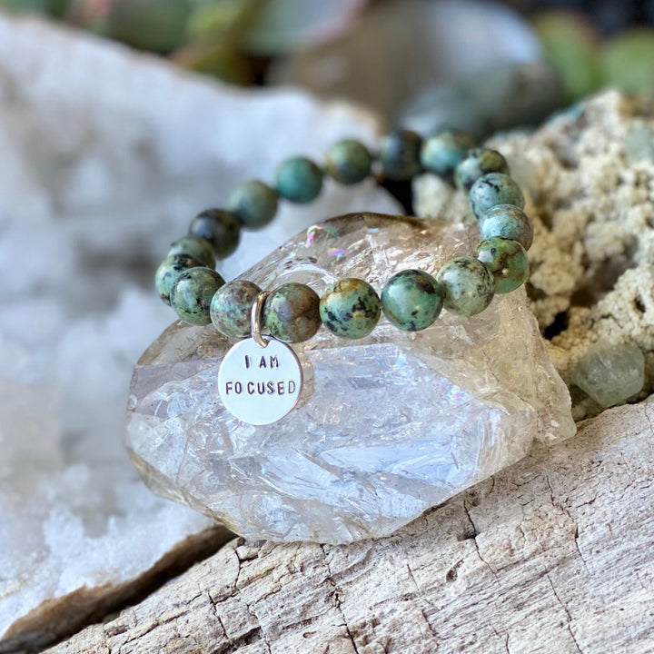 "I am Focused Affirmation Bracelet with African Turquoise for Deeper Understanding of Life. This makes a great gift or present for the wholistic healer in your life. If you know someone who loves holistic meditation, affirmation healing, essential oils, or crystals this ""I am focused"" affirmation is perfect."