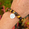 I am Open Minded Affirmation Bracelet with Tiger Eye to See Both Sides of an Argument. There are many ways to see the same situation. Rather than automatically searching for flaws, open your mind (and heart) and seek out the positive aspects of what's going on, or at least another perspective.