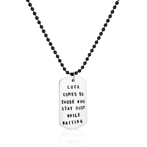 Luck Comes to Those Who Stay Busy While Waiting  - Inspirational Dog Tag Necklace - Sterling Silver Inspirational Dog Tag on Antiqued Black Stainless Steel Necklace.