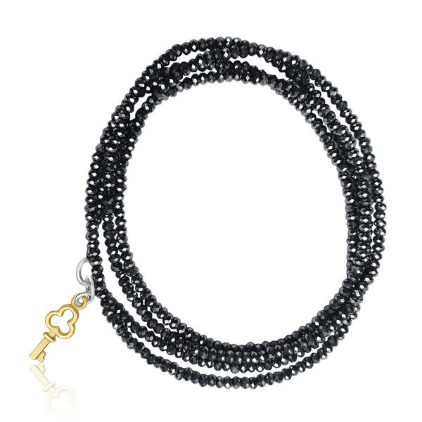 Inspirational Key to Success Midnight Color Crystal Wrap Bracelet with a Brass Key to Help Achieve Your Goals in Life.