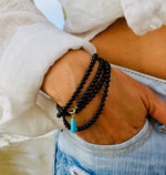 Black Onyx Wrap Bracelet for Self-Control with a Turquoise Dangle Charm