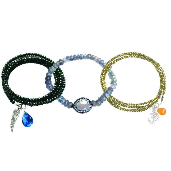 Our Favorite Yoga and Mindfulness Inspired Bracelet Combination: Labradorite Crystal Bracelet for a Positive Change in Your Life, Guardian Angel Wrap Bracelet and Protective Ohm Gold Crystal Wrap Bracelet.