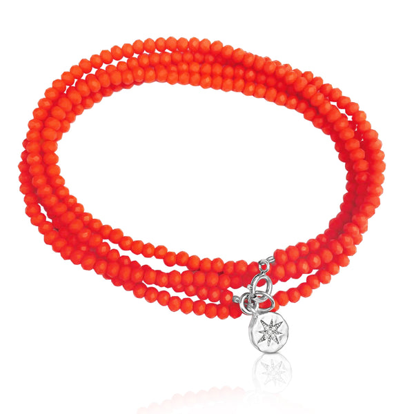 Salmon Color Crystal Wrap Bracelet with Silver Compass Charm for Direction in Your Life. A slightly pinker shade of orange. Salmon color indicates enthusiasm, desire and excitement. Be present wherever you are in your life and in the world. Enjoy every moment of your journey!