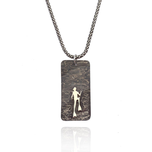 Sterling Silver Scuba Diver Dog Tag features a diver ascending into a sea of bubbles