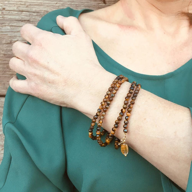 Tiger Eye Wrap Bracelet for Focus -  Mindfulness Yoga Accessory Think of the qualities of the Tiger.  Patient, focused, determined, alert, with perfect timing and slow, deliberate action.  This is Tiger Eyes gift to you.  A bracelet made with a very strong healing stone.