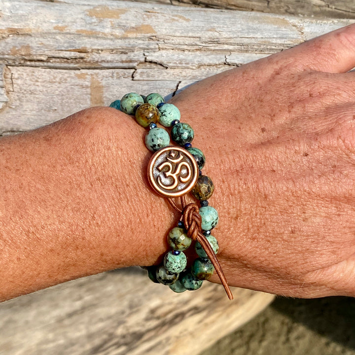 Unisex Turquoise Wrap Bracelet with an Ohm button to Promote Self-Realization from Gogh jewelry Design