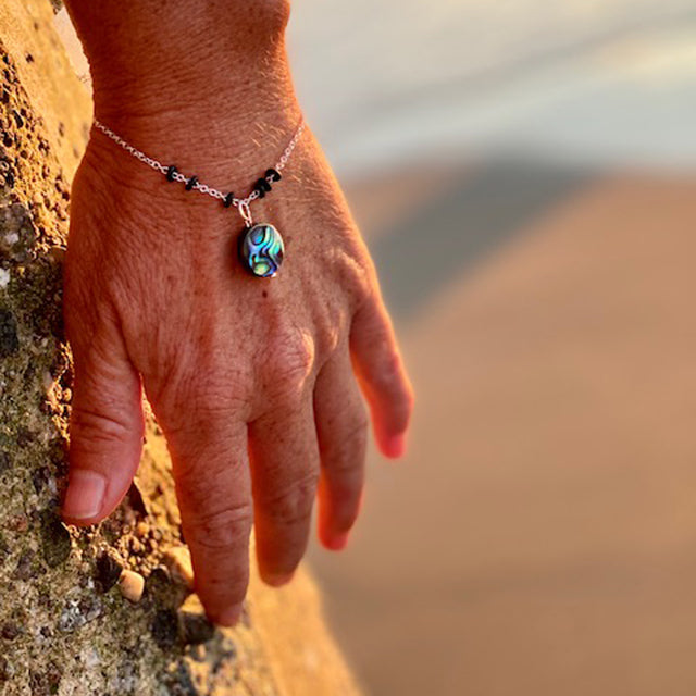 Zero Waste Bracelet with up-recycled SCUBA parts and Abalone pendant from the Pacific Ocean.