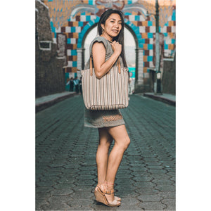 Atol Blanco Purse with model