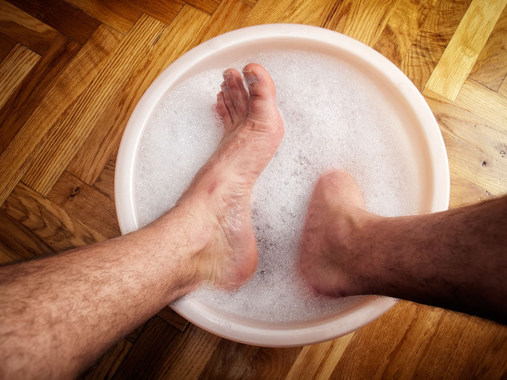 man soaking his feet