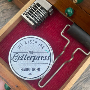 Tiny letterpress sundries cabinet with contents