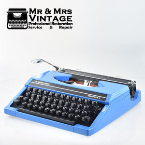 Blue Silverette portable Typewriter by Silver Reed