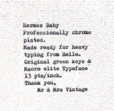 Chrome plated Hermes Baby Typewriter with green Keys.