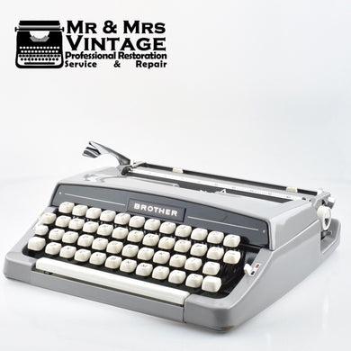 Superb Brother Deluxe Typewriter in Grey  with Leather like Case.