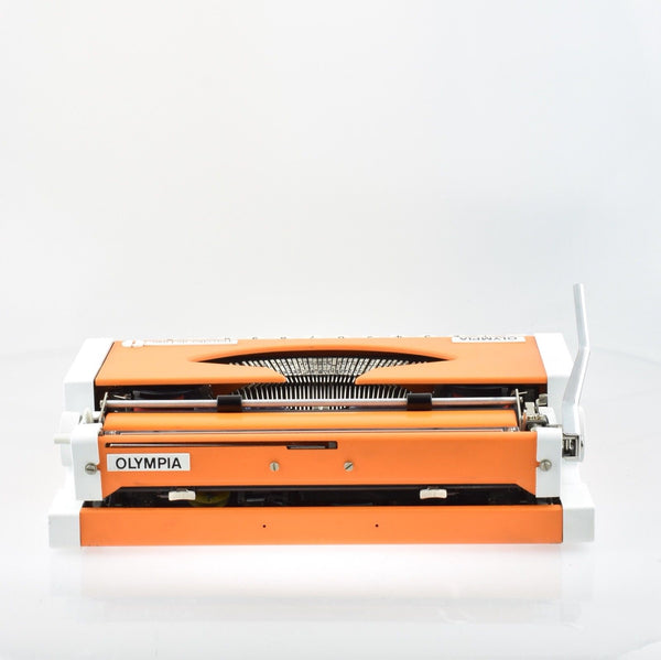 Olympia Traveller Deluxe Typewriter in limited Edition orange and white.