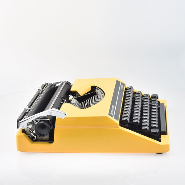 Yellow Silverette Typewriter by Silver Reed