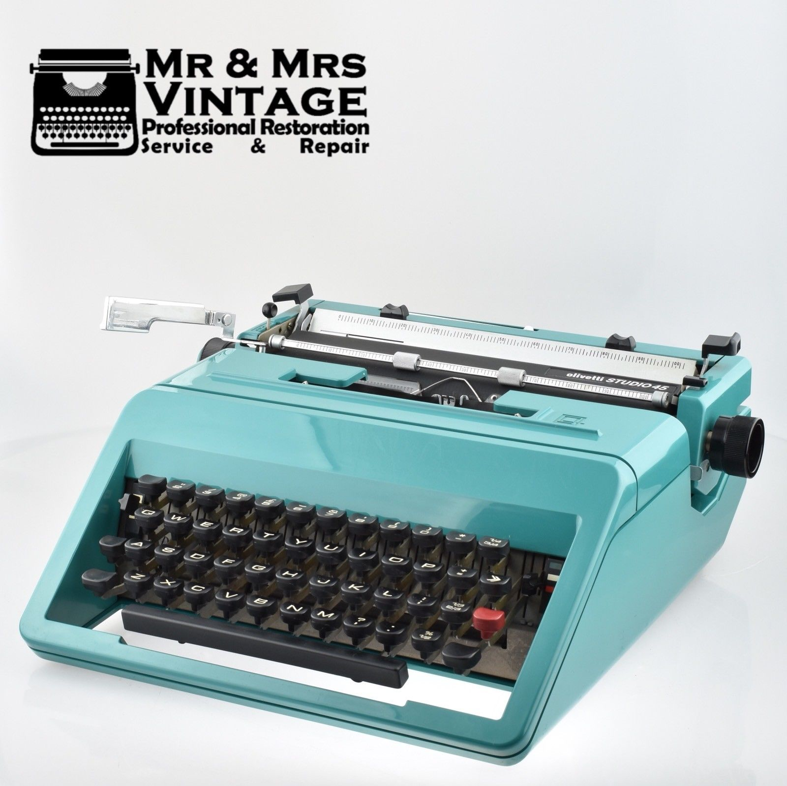 Olivetti Studio 45 Desk Typewriter in Teal Green with Uncommon Carrying Case.