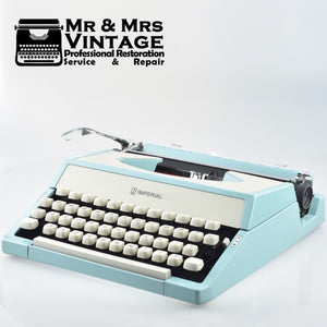 Mint Imperial Litton Portable Typewriter in light baby Blue