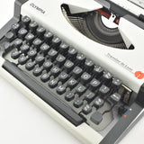 """Like NEW"" Olympia Traveller Deluxe Typewriter"