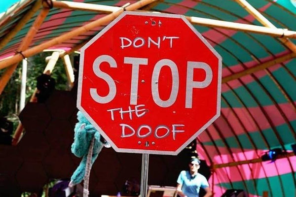 A Stop sign has been modified to say Don't stop the doof.