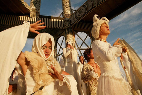 People preying while dressed up at the Burning Man Festival in Black Rock City, 2003