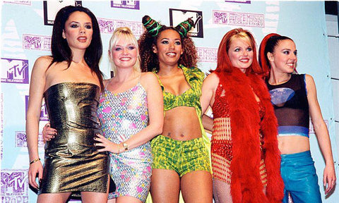 Spice Girls posing for a photo in the 90s showing their festival style