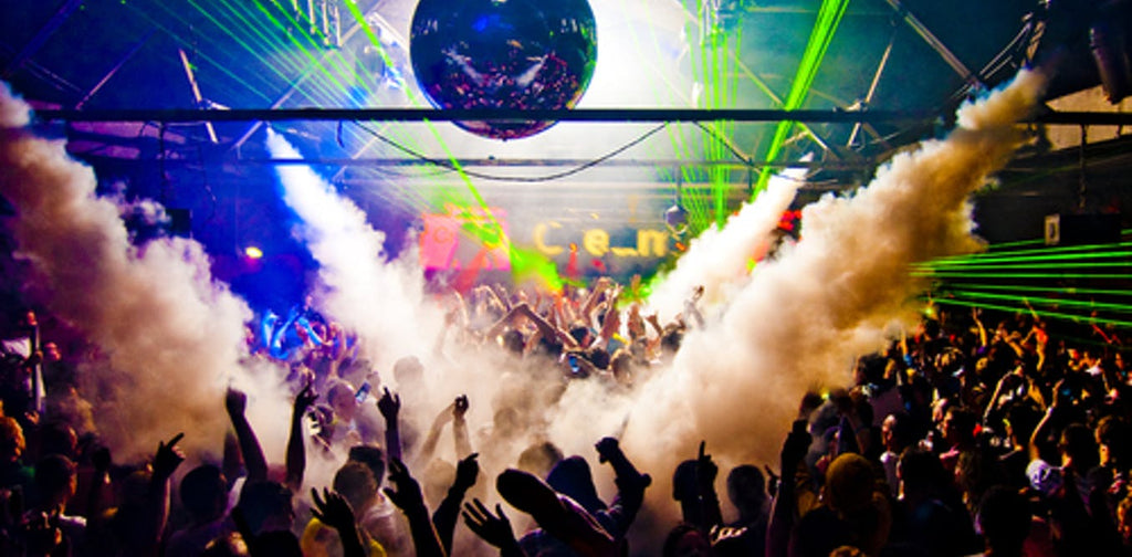 A club fills with smoke and lasers.