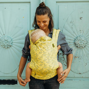 Mother wearing baby in Cheetah 4GS Boba Soft Structured Baby Carrier