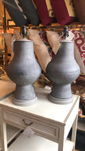 A Pair of Matte Black Ceramic Vessels, Now Mounted as Lamps