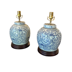 A Pair of Blue & White-Glazed Jars and Covers with a Floral Motif, Now Mounted as Lamps.