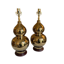 A Pair of Gold-Glazed Double Gourd Vases, Now Mounted as Lamps.