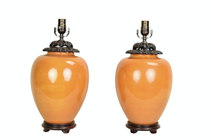 A Pair of Persimmon-Glazed Chinese Jars and Hand-Carved Wooden Covers, Now Mounted as Lamps.