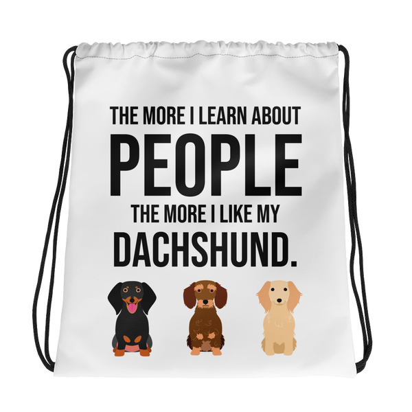The More I Like My Dachshund Drawstring bag